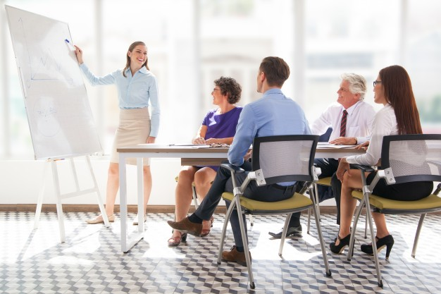 meeting-mature-office-showing-presenter_1262-2083